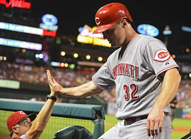 Aug 19, 2014; St. Louis, MO, USA; Cincinnati Reds right fielder Jay Bruce (32) celebrates with manager Bryan Price (38) after scoring during the sixth inning against the St. Louis Cardinals at Busch Stadium. Mandatory Credit: Jeff Curry-USA TODAY Sports