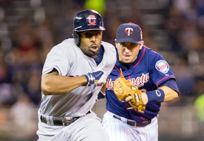 Aug 19, 2014; Minneapolis, MN, USA; Cleveland Indians center fielder Michael Bourn (24) is caught in a run down against Minnesota Twins second baseman Brian Dozier (2) in the sixth inning at Target Field. The Cleveland Indians win 7-5. Mandatory Credit: Brad Rempel-USA TODAY Sports