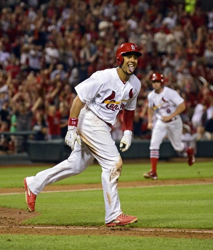Aug 19, 2014; St. Louis, MO, USA; St. Louis Cardinals center fielder Jon Jay (19) celebrates after being hit by a pitch from Cincinnati Reds relief pitcher J.J. Hoover (not pictured) allowing the game winning run to score during the ninth inning at Busch Stadium. The Cardinals defeated the Reds 5-4. Mandatory Credit: Jeff Curry-USA TODAY Sports