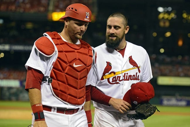 Aug 19, 2014; St. Louis, MO, USA; St. Louis Cardinals relief pitcher Pat Neshek (37) talks with catcher A.J. Pierzynski (35) after the ninth inning against the Cincinnati Reds at Busch Stadium. The Cardinals defeated the Reds 5-4. Mandatory Credit: Jeff Curry-USA TODAY Sports