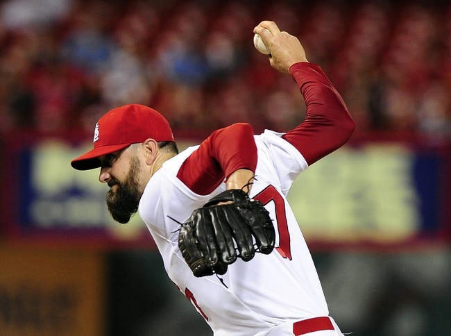 Aug 19, 2014; St. Louis, MO, USA; St. Louis Cardinals relief pitcher Pat Neshek (37) throws to a Cincinnati Reds batter during the ninth inning at Busch Stadium. The Cardinals defeated the Reds 5-4. Mandatory Credit: Jeff Curry-USA TODAY Sports