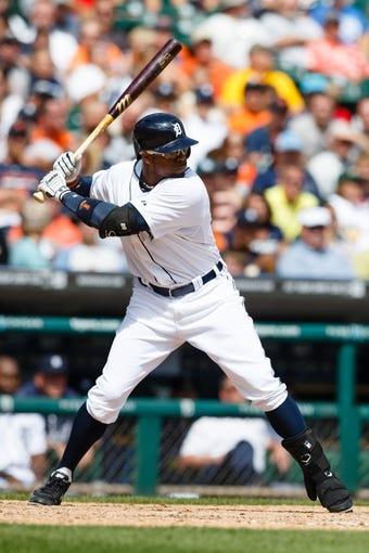 Aug 14, 2014; Detroit, MI, USA; Detroit Tigers left fielder Rajai Davis (20) at bat against the Pittsburgh Pirates at Comerica Park. Mandatory Credit: Rick Osentoski-USA TODAY Sports