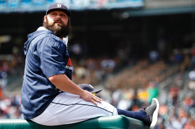 Aug 14, 2014; Detroit, MI, USA; Detroit Tigers relief pitcher Joba Chamberlain (44) sits in dugout before the game against the Pittsburgh Pirates at Comerica Park. Mandatory Credit: Rick Osentoski-USA TODAY Sports