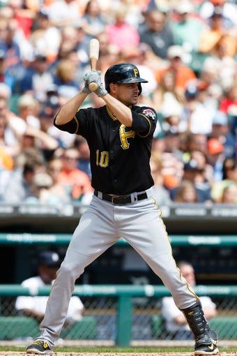 Aug 14, 2014; Detroit, MI, USA; Pittsburgh Pirates shortstop Jordy Mercer (10) at bat against the Detroit Tigers at Comerica Park. Mandatory Credit: Rick Osentoski-USA TODAY Sports