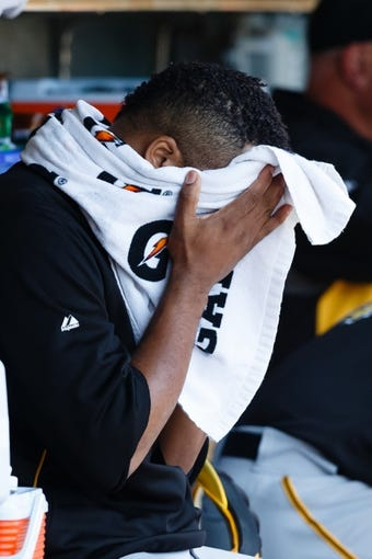Aug 14, 2014; Detroit, MI, USA; Pittsburgh Pirates starting pitcher Francisco Liriano (47) in the dugout against the Detroit Tigers at Comerica Park. Mandatory Credit: Rick Osentoski-USA TODAY Sports