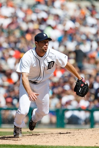 Aug 14, 2014; Detroit, MI, USA; Detroit Tigers starting pitcher Max Scherzer (37) in the field against the Pittsburgh Pirates at Comerica Park. Mandatory Credit: Rick Osentoski-USA TODAY Sports