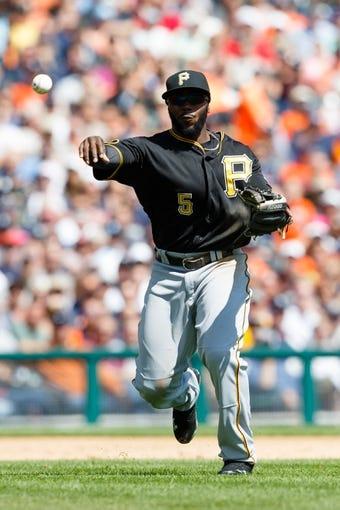 Aug 14, 2014; Detroit, MI, USA; Pittsburgh Pirates third baseman Josh Harrison (5) makes a throw against the Detroit Tigers at Comerica Park. Mandatory Credit: Rick Osentoski-USA TODAY Sports