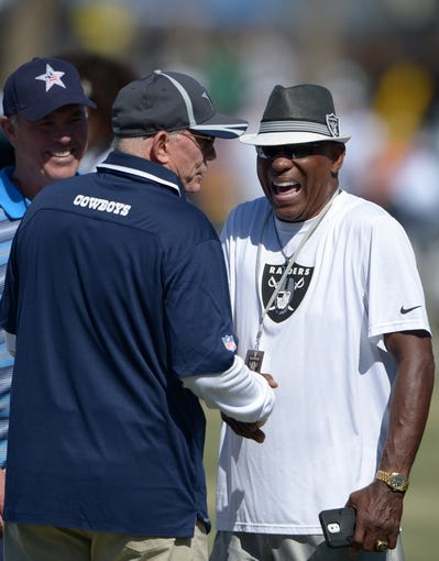 Aug 12, 2014; Oxnard, CA, USA; Dallas Cowboys owner Jerry Jones (left) and Oakland Raiders and Los Angeles Raiders former receiver Cliff Branch at scrimmage at River Ridge Fields. Mandatory Credit: Kirby Lee-USA TODAY Sports