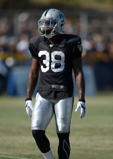Aug 12, 2014; Oxnard, CA, USA; Oakland Raiders cornerback T.J. Carrie (38) at scrimmage against the Dallas Cowboys at River Ridge Fields. Mandatory Credit: Kirby Lee-USA TODAY Sports