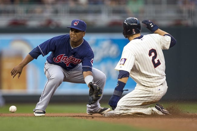 Aug 20, 2014; Minneapolis, MN, USA; Minnesota Twins second baseman Brian Dozier (2) steals second base before Cleveland Indians shortstop Jose Ramirez (11) can make a tag in the first inning at Target Field. Mandatory Credit: Jesse Johnson-USA TODAY Sports