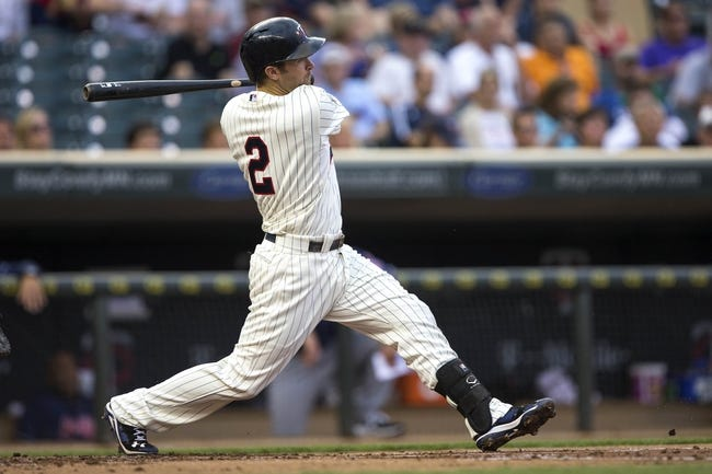 Aug 20, 2014; Minneapolis, MN, USA; Minnesota Twins second baseman Brian Dozier (2) hits a single in the second inning against the Cleveland Indians at Target Field. Mandatory Credit: Jesse Johnson-USA TODAY Sports