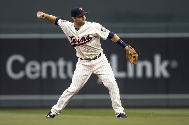 Aug 20, 2014; Minneapolis, MN, USA; Minnesota Twins second baseman Brian Dozier (2) throws the ball to first base for an out in the first inning against the Cleveland Indians at Target Field. Mandatory Credit: Jesse Johnson-USA TODAY Sports