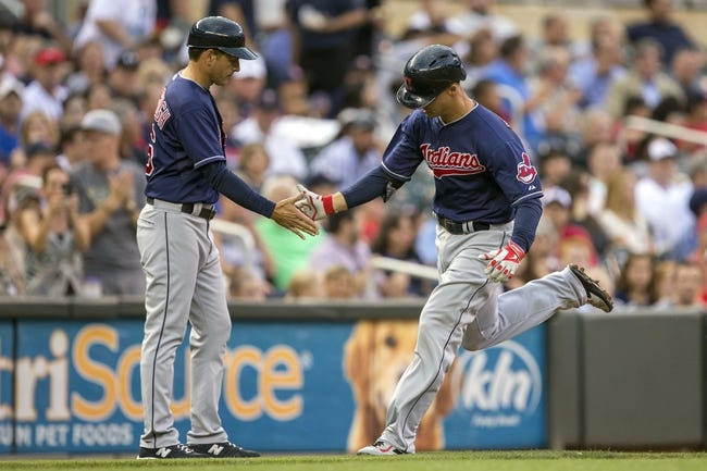 Aug 20, 2014; Minneapolis, MN, USA; Cleveland Indians designated hitter Zach Walters (6) celebrates with third base coach Mike Sarbaugh (16) after hitting a home run in the second inning against the Minnesota Twins at Target Field. Mandatory Credit: Jesse Johnson-USA TODAY Sports