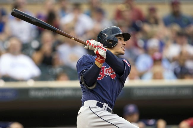 Aug 20, 2014; Minneapolis, MN, USA; Cleveland Indians designated hitter Zach Walters (6) hits a home run in the second inning against the Minnesota Twins at Target Field. Mandatory Credit: Jesse Johnson-USA TODAY Sports