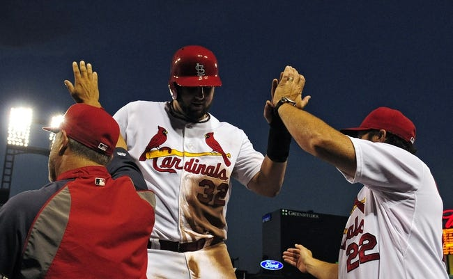 Aug 20, 2014; St. Louis, MO, USA; St. Louis Cardinals first baseman Matt Adams (32) is congratulated by bench coach Mike Aldrete (28) and manager Mike Matheny (22) after scoring during the fifth inning against the Cincinnati Reds at Busch Stadium. Mandatory Credit: Jeff Curry-USA TODAY Sports