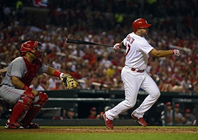 Aug 20, 2014; St. Louis, MO, USA; St. Louis Cardinals shortstop Jhonny Peralta (27) hits a three run double off of Cincinnati Reds starting pitcher Johnny Cueto (not pictured) during the fifth inning at Busch Stadium. Mandatory Credit: Jeff Curry-USA TODAY Sports