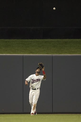 Aug 20, 2014; Minneapolis, MN, USA; Minnesota Twins center fielder Danny Santana (39) catches a fly ball in the eighth inning against the Cleveland Indians at Target Field. The Indians won 5-0. Mandatory Credit: Jesse Johnson-USA TODAY Sports