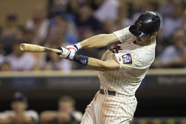 Aug 20, 2014; Minneapolis, MN, USA; Minnesota Twins first baseman Joe Mauer (7) hits a single eighth inning against the Cleveland Indians at Target Field. The Indians won 5-0. Mandatory Credit: Jesse Johnson-USA TODAY Sports
