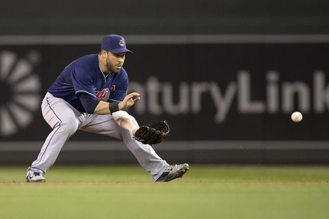 Aug 20, 2014; Minneapolis, MN, USA; Cleveland Indians second baseman Jason Kipnis (22) fields a ground ball in the ninth inning against the Minnesota Twins at Target Field. The Indians won 5-0. Mandatory Credit: Jesse Johnson-USA TODAY Sports