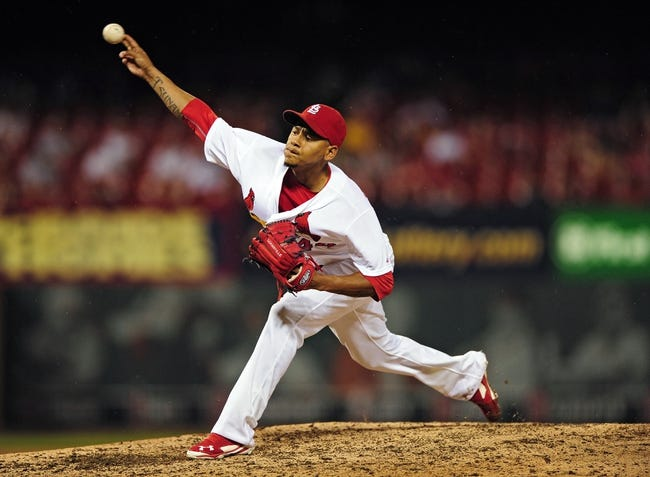 Aug 20, 2014; St. Louis, MO, USA; St. Louis Cardinals relief pitcher Carlos Martinez (44) throws to a Cincinnati Reds batter during the eighth inning at Busch Stadium. The Cardinals defeated the Reds 7-3. Mandatory Credit: Jeff Curry-USA TODAY Sports