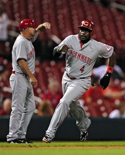 Aug 20, 2014; St. Louis, MO, USA; Cincinnati Reds second baseman Brandon Phillips (4) scores during the ninth inning against the St. Louis Cardinals at Busch Stadium. The Cardinals defeated the Reds 7-3. Mandatory Credit: Jeff Curry-USA TODAY Sports