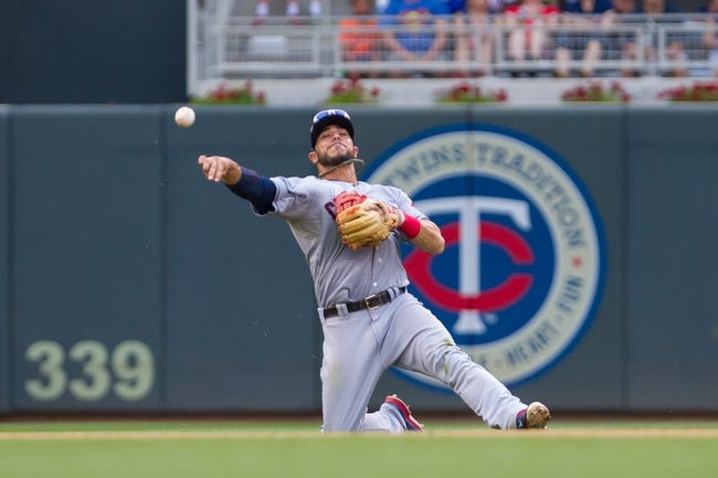 Aug 21, 2014; Minneapolis, MN, USA; Cleveland Indians shortstop Mike Aviles (4) throws from his knees in the eighth inning against the Minnesota Twins at Target Field. The Minnesota Twins win 4-1. Mandatory Credit: Brad Rempel-USA TODAY Sports
