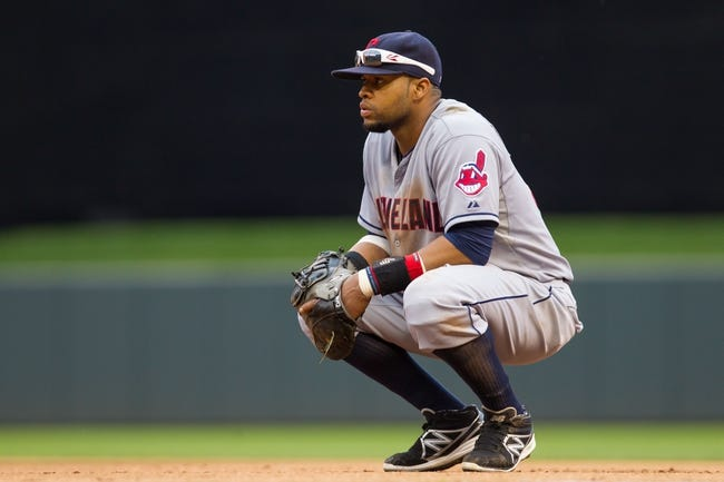 Aug 21, 2014; Minneapolis, MN, USA; Cleveland Indians first baseman Carlos Santana (41) waits for the play in the eighth inning against the Minnesota Twins at Target Field. The Minnesota Twins win 4-1. Mandatory Credit: Brad Rempel-USA TODAY Sports