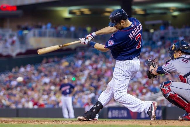 Aug 19, 2014; Minneapolis, MN, USA; Minnesota Twins first baseman Joe Mauer (7) at bat against the Cleveland Indians at Target Field. Mandatory Credit: Brad Rempel-USA TODAY Sports