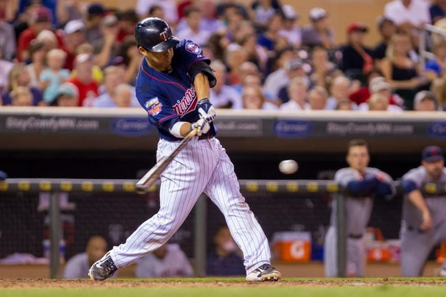 Aug 19, 2014; Minneapolis, MN, USA; Minnesota Twins catcher Kurt Suzuki (8) at bat against the Cleveland Indians at Target Field. Mandatory Credit: Brad Rempel-USA TODAY Sports
