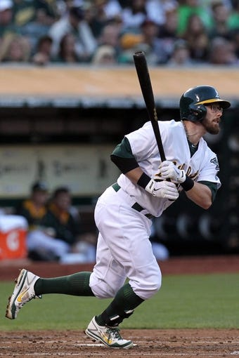 Aug 8, 2014; Oakland, CA, USA; Oakland Athletics shortstop Eric Sogard (28) in the third inning of their MLB baseball game with the Minnesota Twins at O.co Coliseum. Mandatory Credit: Lance Iversen-USA TODAY Sports. A's won 6-5
