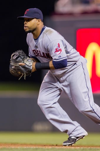 Aug 19, 2014; Minneapolis, MN, USA; Cleveland Indians first baseman Carlos Santana (41) fields a ground ball against the Minnesota Twins at Target Field. Mandatory Credit: Brad Rempel-USA TODAY Sports