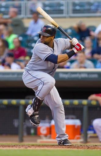 Aug 19, 2014; Minneapolis, MN, USA; Cleveland Indians first baseman Carlos Santana (41) at bat against the Minnesota Twins at Target Field. Mandatory Credit: Brad Rempel-USA TODAY Sports