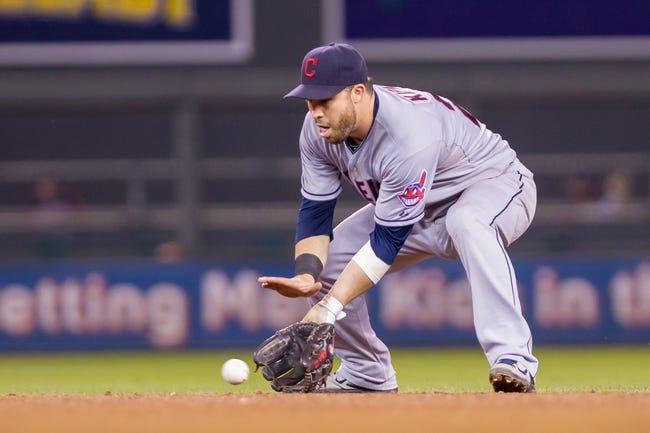 Aug 19, 2014; Minneapolis, MN, USA; Cleveland Indians second baseman Jason Kipnis (22) fields a ground ball against the Minnesota Twins at Target Field. Mandatory Credit: Brad Rempel-USA TODAY Sports