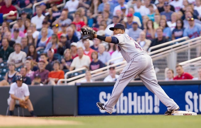 Aug 19, 2014; Minneapolis, MN, USA; Cleveland Indians first baseman Carlos Santana (41) catches a ball at first against the Minnesota Twins at Target Field. Mandatory Credit: Brad Rempel-USA TODAY Sports