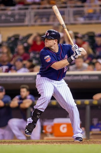 Aug 19, 2014; Minneapolis, MN, USA; Minnesota Twins first baseman Chris Parmelee (27) at bat against the Cleveland Indians at Target Field. Mandatory Credit: Brad Rempel-USA TODAY Sports