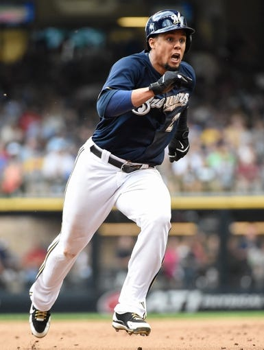Aug 20, 2014; Milwaukee, WI, USA; Milwaukee Brewers center fielder Carlos Gomez (27) during the game against the Toronto Blue Jays at Miller Park. Mandatory Credit: Benny Sieu-USA TODAY Sports