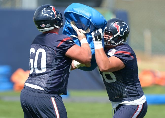 Aug 21, 2014; Englewood, CO, USA; Houston Texans center Ben Jones (60) and center James Ferentz (78) participate in blocking drills during scrimmage against the Denver Broncos at the Broncos Headquarters. Mandatory Credit: Kirby Lee-USA TODAY Sports