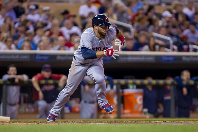 Aug 19, 2014; Minneapolis, MN, USA; Cleveland Indians shortstop Mike Aviles (4) runs to first against the Minnesota Twins at Target Field. Mandatory Credit: Brad Rempel-USA TODAY Sports