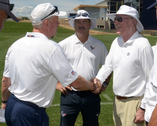 Aug 21, 2014; Englewood, CO, USA; Denver Broncos coach John Fox (left) shakes hands with Houston Texans chief operating officer D. Cal McNair (center) and owner Bob McNair (right) after scrimmage at the Broncos Headquarters. Mandatory Credit: Kirby Lee-USA TODAY Sports