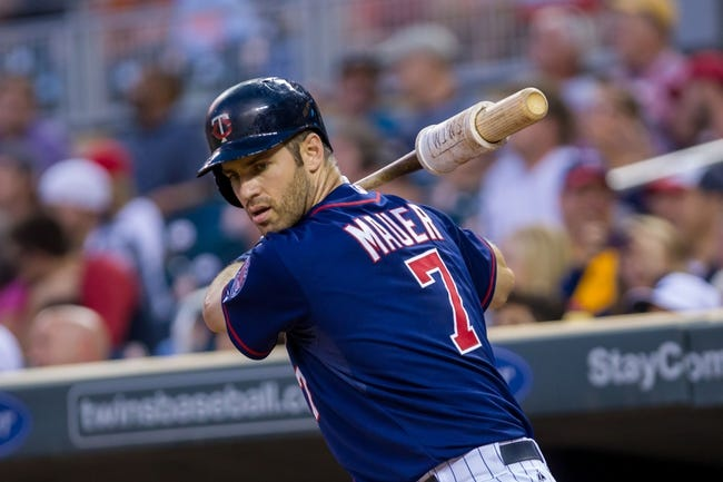 Aug 19, 2014; Minneapolis, MN, USA; Minnesota Twins first baseman Joe Mauer (7) in the on deck circle against the Cleveland Indians at Target Field. Mandatory Credit: Brad Rempel-USA TODAY Sports