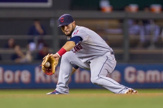 Aug 19, 2014; Minneapolis, MN, USA; Cleveland Indians shortstop Mike Aviles (4) fields a ground ball against the Minnesota Twins at Target Field. Mandatory Credit: Brad Rempel-USA TODAY Sports