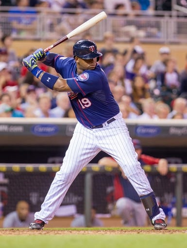 Aug 19, 2014; Minneapolis, MN, USA; Minnesota Twins designated hitter Kennys Vargas (19) at bat against the Cleveland Indians at Target Field. Mandatory Credit: Brad Rempel-USA TODAY Sports