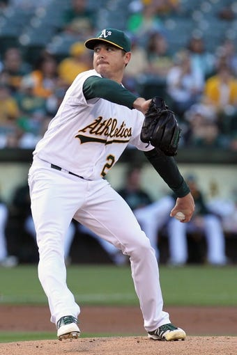 Aug 8, 2014; Oakland, CA, USA; Oakland Athletics starting pitcher Scott Kazmir (26) throws to the Minnesota Twins in the first inning of their MLB baseball game at O.co Coliseum. Mandatory Credit: Lance Iversen-USA TODAY Sports