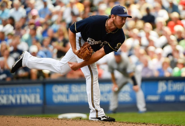 Aug 20, 2014; Milwaukee, WI, USA; Milwaukee Brewers pitcher Zach Duke (59) during the game against the Toronto Blue Jays at Miller Park. Mandatory Credit: Benny Sieu-USA TODAY Sports