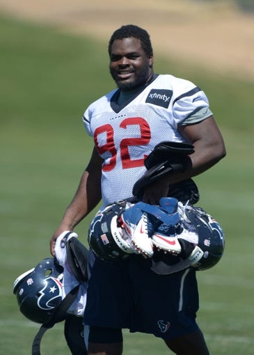 Aug 21, 2014; Englewood, CO, USA; Houston Texans defensive tackle Louis Nix (92) carries helmets and shoulder pads during scrimmage against the Denver Broncos at the Broncos Headquarters. Mandatory Credit: Kirby Lee-USA TODAY Sports
