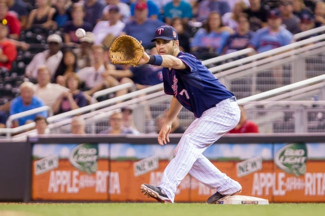 Aug 19, 2014; Minneapolis, MN, USA; Minnesota Twins first baseman Joe Mauer (7) catches a ball at first against the Cleveland Indians at Target Field. Mandatory Credit: Brad Rempel-USA TODAY Sports