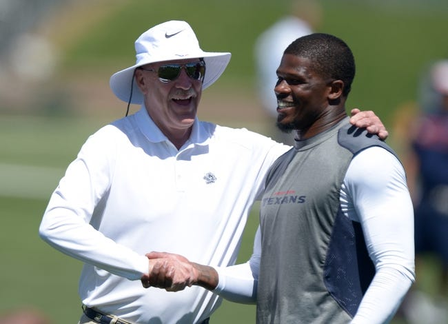 Aug 21, 2014; Englewood, CO, USA; Houston Texans owner Bob McNair (left) shakes hands with receiver Andre Johnson during scrimmage against the Denver Broncos at the Broncos Headquarters. Mandatory Credit: Kirby Lee-USA TODAY Sports