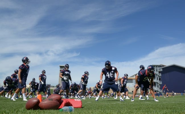 Aug 21, 2014; Englewood, CO, USA; Houston Texans players warmup with stretching exercises before scrimmage against the Denver Broncos at the Broncos Headquarters. Mandatory Credit: Kirby Lee-USA TODAY Sports