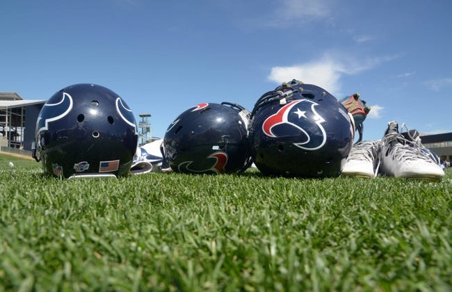 Aug 21, 2014; Englewood, CO, USA; General view of Houston Texans helmets and Nike cleats during scrimmage against the Denver Broncos at the Broncos Headquarters. Mandatory Credit: Kirby Lee-USA TODAY Sports