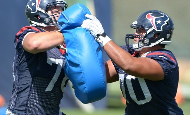 Aug 21, 2014; Englewood, CO, USA; Houston Texans center James Ferentz (78) and guard Xavier Su'a-Filo (70) participate in blocking drills during scrimmage against the Denver Broncos at the Broncos Headquarters. Mandatory Credit: Kirby Lee-USA TODAY Sports